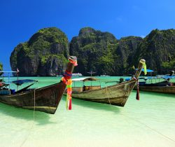Long tail wooden boats moored at Maya Bay-Phi Phi Islands-Thailand