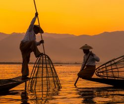 Fishermen sihouettes at Inle lake on sunset, Myanmar