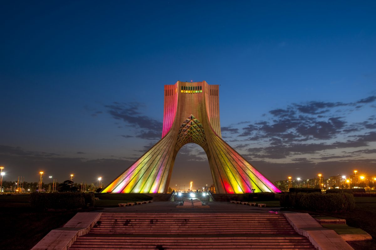 Photo of the Azadi Tower in Iran lit up at night