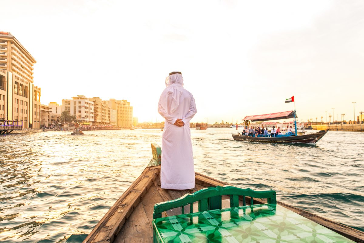 Arabian man on abra boat on Creek's canal